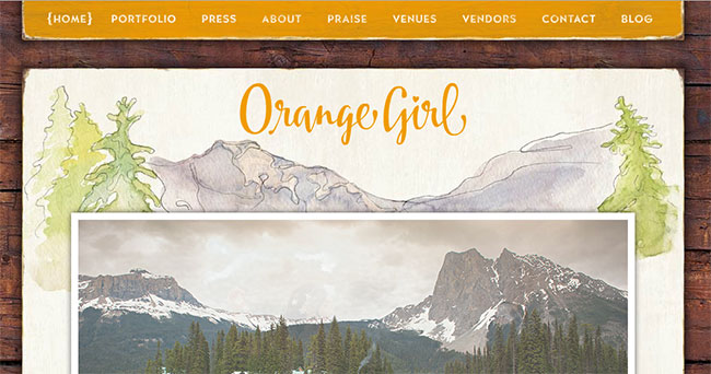 Orange Girl uses a watercolor mountain scene as the backdrop for her blog.